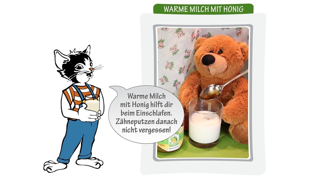 Kater Moritz mit einem Glas Milch mit Honig - daneben Teddybär