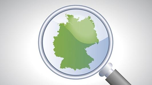 Grafik Deutschlandkarte mit Lupe