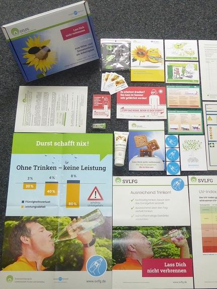 Inhalt der Info-Box zum Hitze- und Sonnenschutz mit Giveaways, Broschüren und Flyer